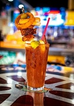 A 22 Ounce Bloody Mary Topped with Grilled Cheese, Wings and More Kicks Off Football Promos at Sickies Garage