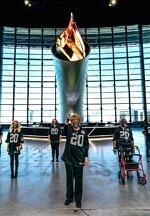 Raiders in the Community - Cancer Survivors Light Al Davis Memorial Torch