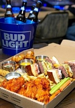 "Go Bottoms Up on ""Beer Game Sunday"" with Party Packs and Beer Buckets at PT's Taverns"