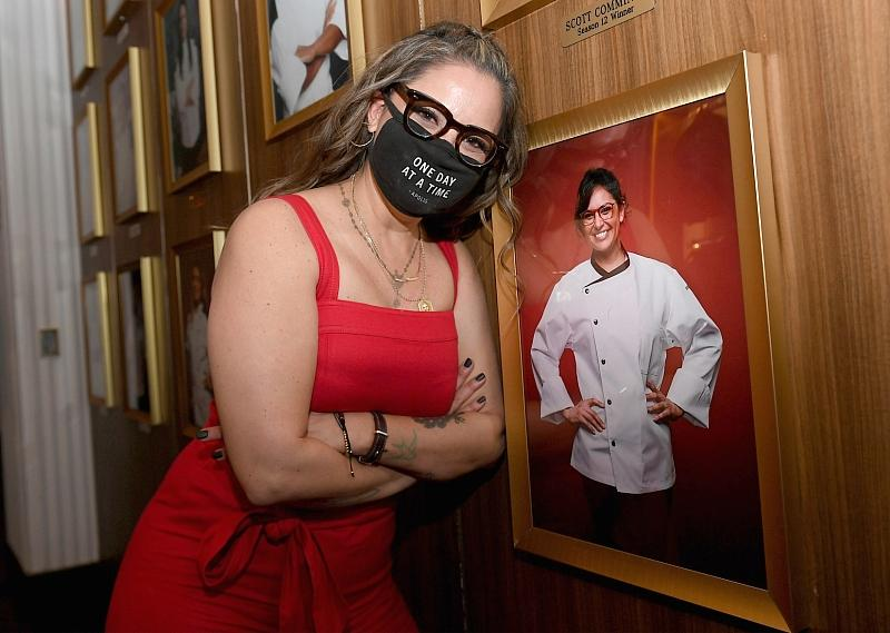 Kori Sutton poses next to her photo addition to the winner's wall at Gordon Ramsay HELL'S KITCHEN at Caesars Palace