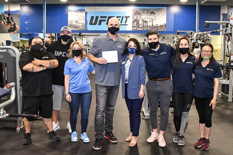 Adam Sedlack, Commissioner Michael Naft, Justin Akari, Jessica Eye and UFC FIT Silverado Ranch team with the proclamation from the county