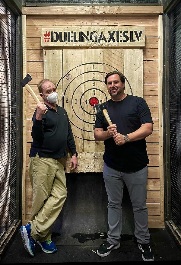 Teller and J Dapper pose for a photo inside Dueling Axes. (Photo credit: Ava Rose Agency)