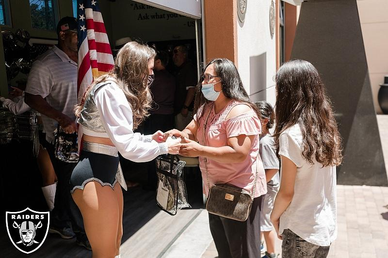 Raiderette distributes Raiders-themed gift bags on Memorial Day at Share VillagePHOTO3-Raiderette distributes Raiders-themed gift bags on Memorial Day at Share Village