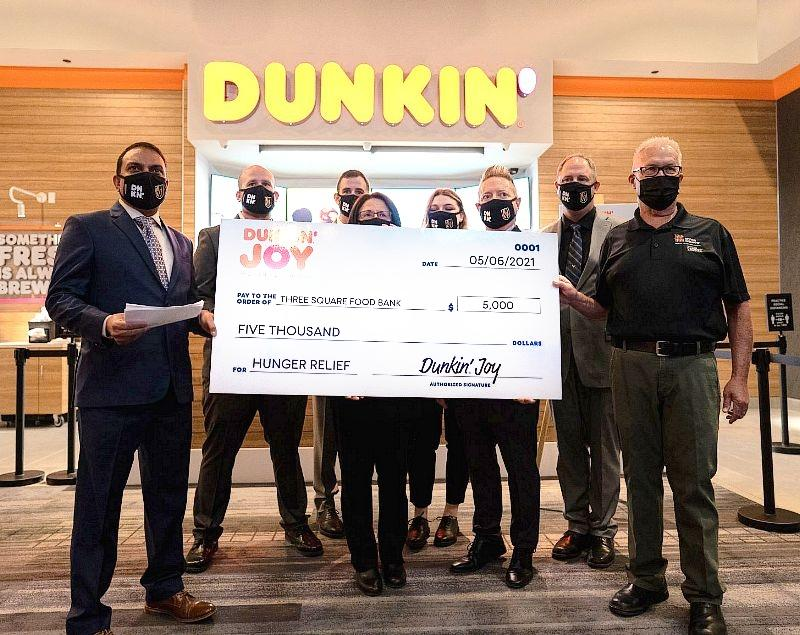 Dunkin' presents Three Square Food Bank a $5,000 donation