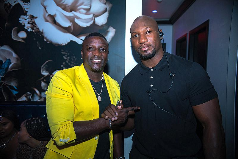 Akon poses for a photo with security (photo credit: Bernard Van Weydeveldt)