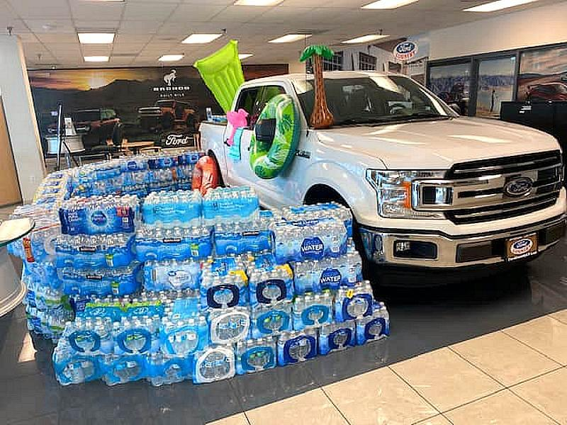 Ford dealerships collected cases of water to support The Salvation Army
