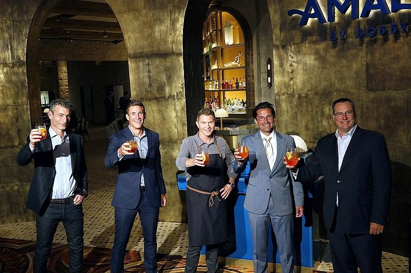 (L to R) – Business Partner Laurence Kretchmer, Caesars Entertainment President & COO Anthony Carano, Chef Bobby Flay, Caesars Entertainment Regional President Sean McBurney, Caesars Entertainment CEO Tom Reeg at the Amalfi by Bobby Flay Grand Opening Event at Caesars Palace Las Vegas