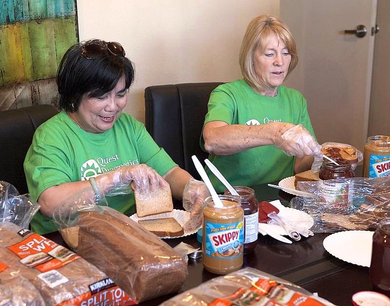 Volunteers making PB&Js for homeless kids