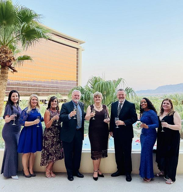 Christine Greengrass with employees of CAMCO at the Community Associations Institute (CAI) Nevada Chapter Awards Gala on July 16