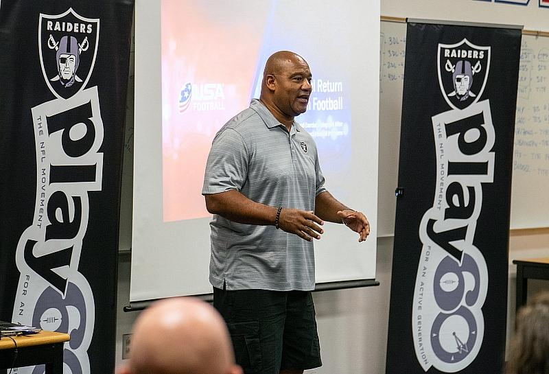 Raiders Alumnus Chris McLemore and Las Vegas native talks to coaches during clinic