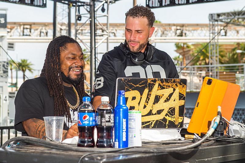 Marshawn Lynch and DJ Buza at Bud Light Beer Garden