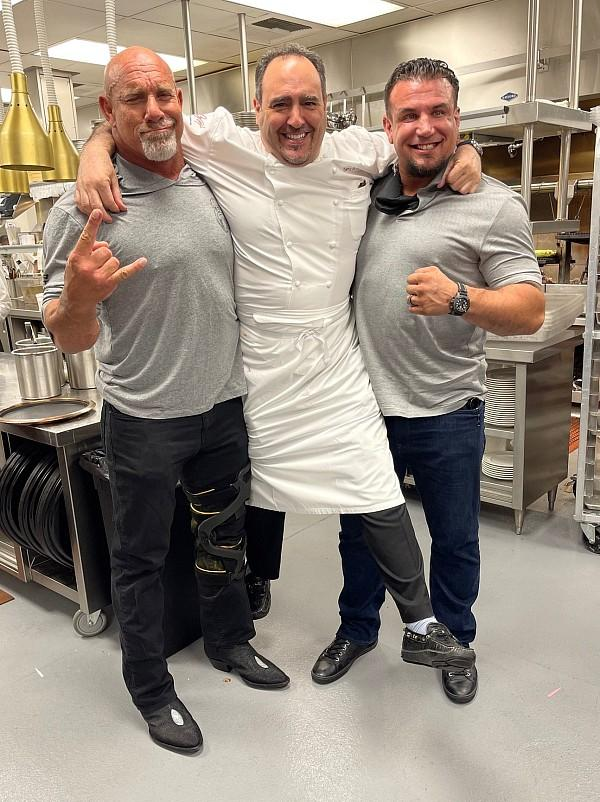 WWE Hall of Famer Bill Goldberg and MMA star Frank Mir joke around with Chef Barry in the kitchen at Barry's Prime