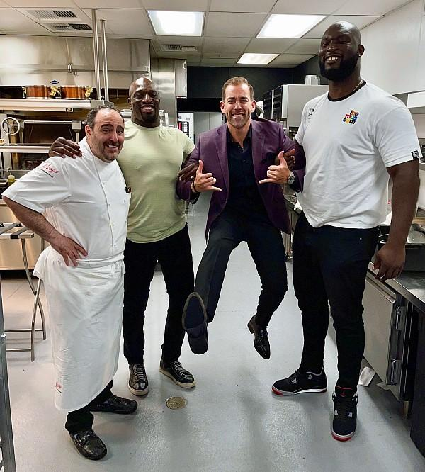 WWE star Titus O'Neil with tag team champ OMOS joke with Chef Barry by trying to escort co-owner Yassine Lyoubi out of his own kitchen at Barrys