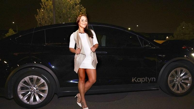 Jessica Eye poses for a photo with a Kaptyn Tesla Model X. (Photo credit: DDWPIX)