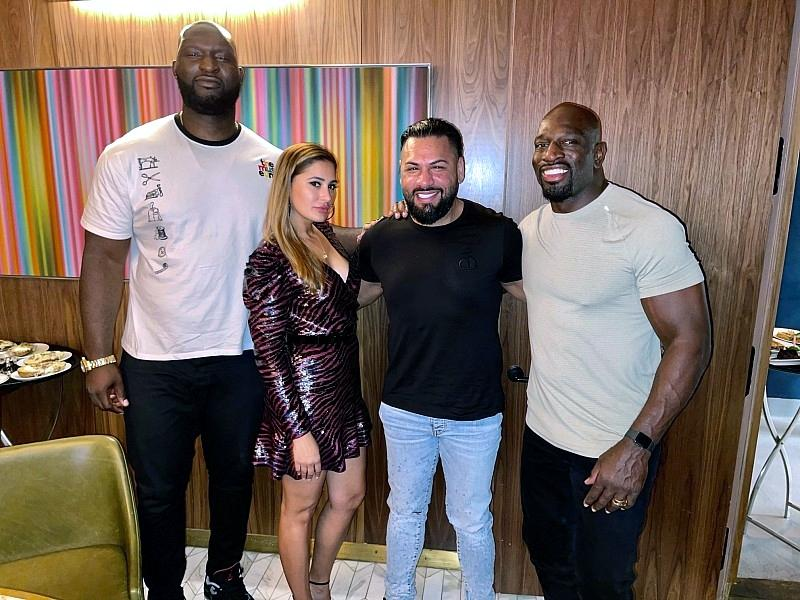 Famous Bollywood actress Nargis Fakhri and businessman Jas Mathur catching up with WWE stars Titus O'Neil and Omos at Barry's Downtown Prime